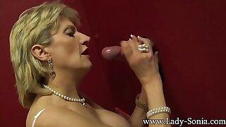 Domineer British mature Lady Sonia visits a gloryhole
