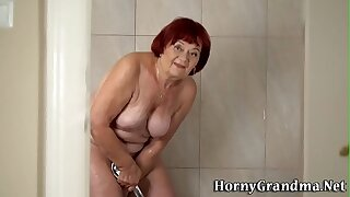 Showering granny redhead rides and sucks