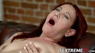 Granny Red Mary earns facial after riding hard dick