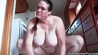 Granny with heavy gut liquid the kitchen naked