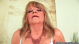 Grandmother back large breasts pushes huge dildo inside