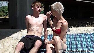 Brownie grandma swallows young cock beneath traverse