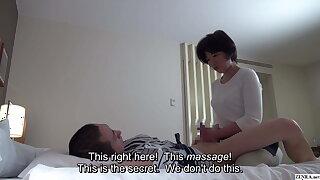 Japanese hotel massage – mature masseuse gives handjob
